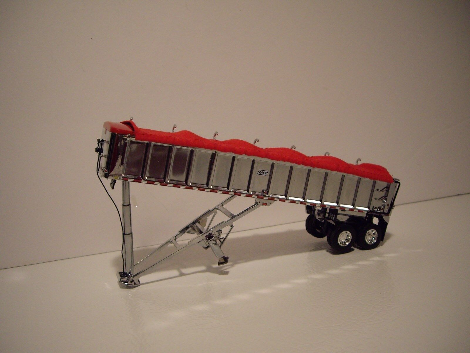 DCP FIRST GEAR 1/64 TANDEM AXLE CHROME WITH RED TARP EAST END DUMP