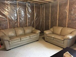 Beige leather couch and love seat