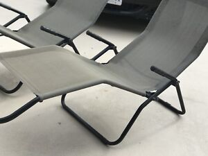 A pair of Zero Gravity Lounge Chairs