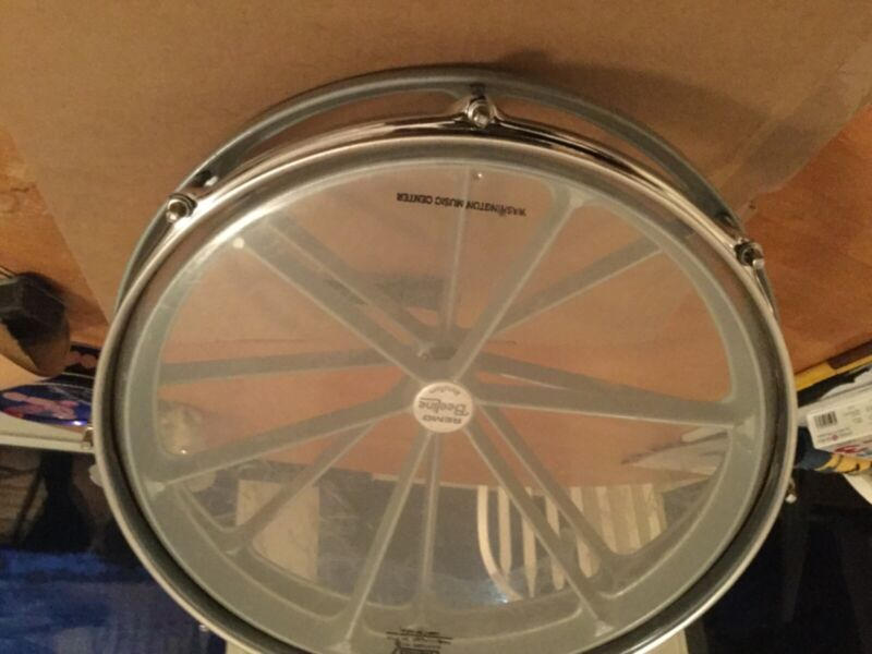 "14""Remo Roto tom in very nice condition .Works as its suppose to...fun !"
