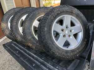 Set of 4 Jeep wheels and tires 5x5 bolt pattern