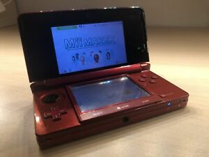 Nintendo 3DS and Games and Game Holder.