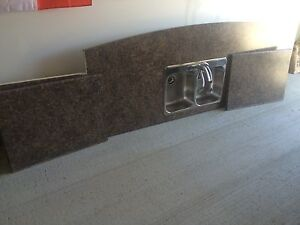 Brand new kitchen countertop with sink.