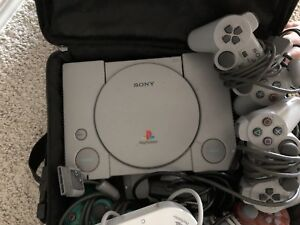 PlayStation console with 4 remotes and party bar