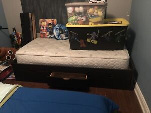 Single platform bed with  mattress.