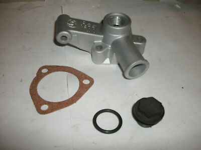 MGB THERMOSTAT HOUSING 1977-1980 MGB   NEW WITH OEM PLASTIC PLUG, SEAL & GASKET