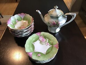 Antique Prussia teapot, saucers and nappies