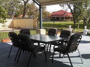 Outdoor Setting - Table, 8 Chairs and a Glass Topped Coffee Table Erskine Mandurah Area Preview