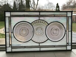 Stained glass window with depression glass