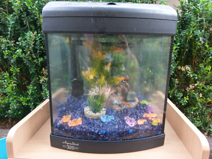 Aqua one 320 fish tank with decorations and rocks