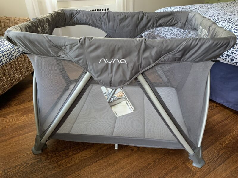 Nuna Sena Aire Travel Crib (full size) with 3 Sets of Sheets - Graphite