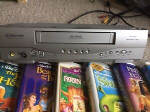 VCR and 9 VHS Tapes