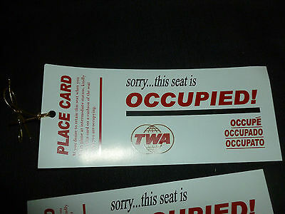 (1) Vintage TWA Occupied Seat Card – 1980's - Card Stock w/Gold Stretch Cord