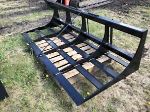Land leveller for skid steer