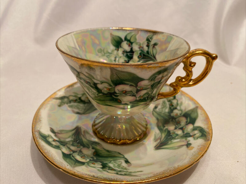 "Vintage ""Lily Of The Valley"" Iridescent Footed Teacup And Saucer Gold Trim"