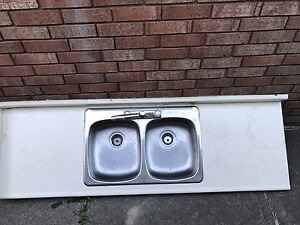 Sink top and faucet