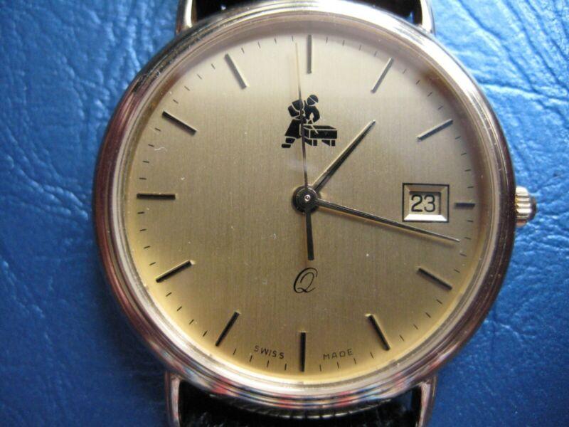 Echtgolduhr 585/000 zirka 19 g. Gold , Schweizer Uhrwerk, mit Steinmetzemblem