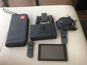 Nintendo Switch + 128GB SD + Case + Glass Screen. Barely used