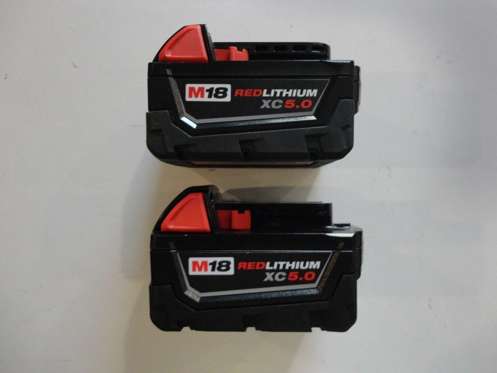 (2) MILWAUKEE 18V 18 Volt L i- Ion 48-11-1850 XC 5.0 AH Battery packs 48-11-1852 2