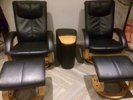 two recliner chairs with foot stools and console/drink holder