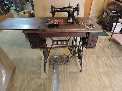 Antique Singer Treadle Sewing Machine Model 28 1910 Cast iron Base Wood Cabinet