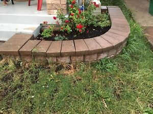 FREE - pick up Tuesday-landscaping corner flower bed stones