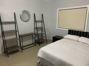 Large twin share room with private bathroom and fridge