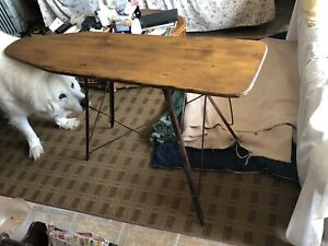Antique wooden stained ironing board.