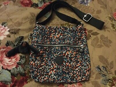 KIPLING BAG & MONKEY.GOOD SIZE CROSS OVER STYLE NEW CONDITION.COSTS OVER £50 NEW