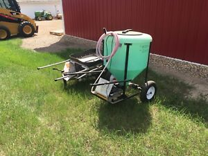 NCR SEED TREATER, 610 JD CULT, 18.4X34 CHAINS