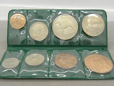 COINS OF IRELAND 8 COIN SET W/ GREEN HOLDER MISC. YEARS