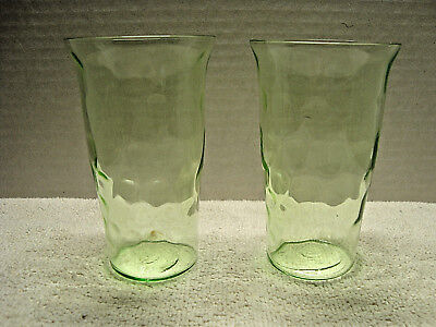 Two Green vaseline glass juice glass in the thumb print pattern.