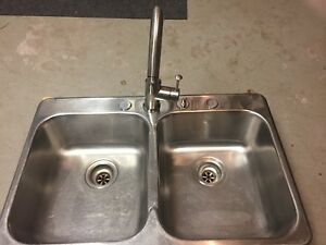 Stainless steal sink and faucet.