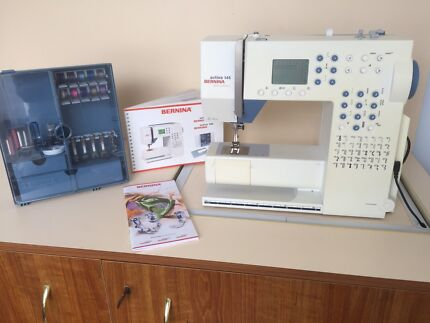 Complete sewing system and cabinet.