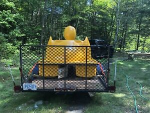 Rubber ducky paddle boat with flatbed trailer