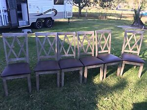 6 seater solid timber dining table set with 6 leather cushion seats Thagoona Ipswich City Preview