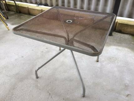 Outdoor steel table with Steel mesh top.  As pictured.