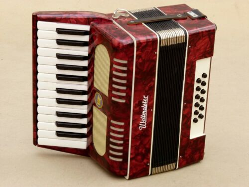 Very Nice Accordion Weltmeister 12 bass including case.
