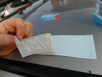 Peeling the decal away from the backing paper