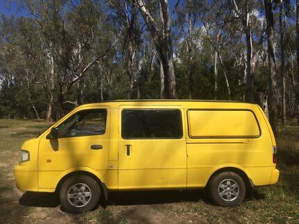 Yellow kia campervan 2004