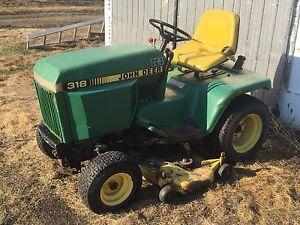 318 John Deere garden tractor and blower