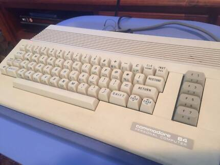 Commodore 64 Vintage Computer Bundle with Cassette Deck and Games