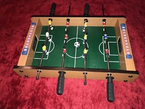 "Foosball game, table top 20"" L x 12"" W"