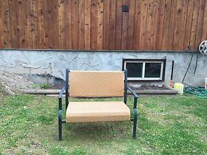 Yellow wicker steel bench