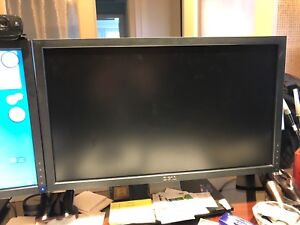 "Two dell 24"" monitors and desktop with keyboard and mouse"