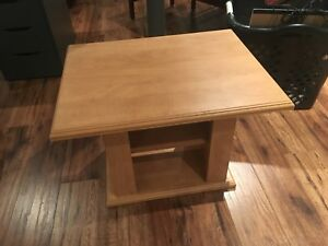 Solid wood table with shelving area