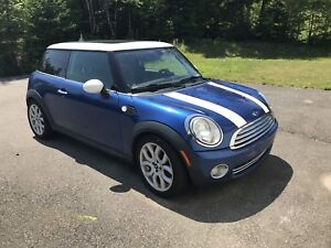 2009 Mini Cooper 6 speed. Great on gas