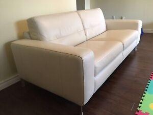 White Natuzzi genuine leather sofa in brand new condition