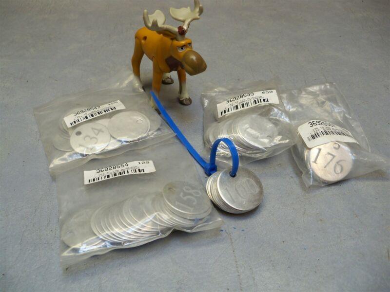 "1-1/4"" Diameter checks Metal numbered tags Round lot #s 101-200"