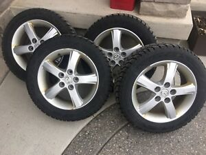 Winter tires on aluminum rims.